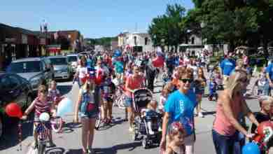 Photo of Charles City preparing for Kid's Day to kick off weekend celebrations
