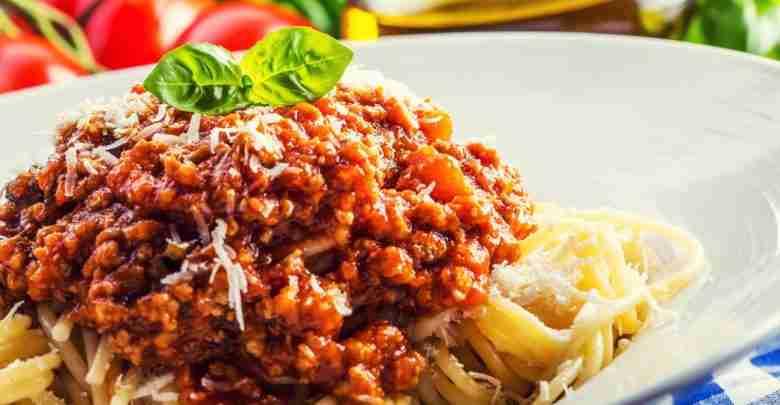Spaghetti. Spaghetti bolognese and basil leaves.