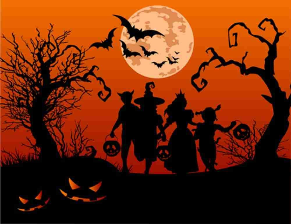 Halloween Trick Or Treat Silhouette.Halloween Background With Silhouettes Of Children Trick Or