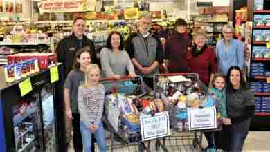 Photo of Radio edges Newspaper in annual grocery cart race benefiting local food banks