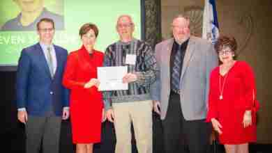 Photo of Schiller honored for dedication to volunteerism, community