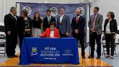 Photo of Governor Reynolds inks 'Logan's Law'