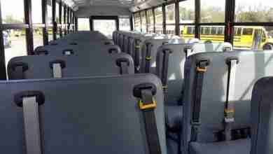 Photo of Charles City Schools adding seat belts to all buses within the decade