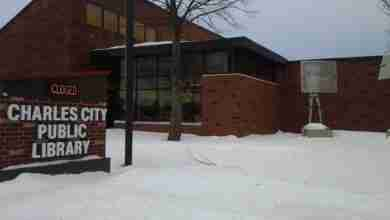 Photo of Charles City Public Library running 'curb-side service' for all material; all due dates extended