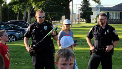 "Photo of NH Police Respond To ""Unfair"" Baseball Game; Helps Students Win"